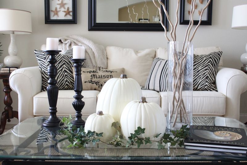 white pumpkins, white candles in black candleholders and greenery for a chic vintage inspired coffee table display