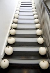 line up the staircase with white pumpkins to make your home feel like fall