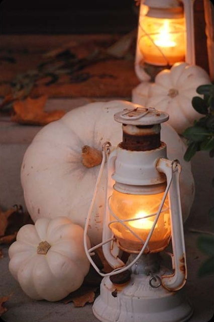 decorate your front porch with white pumpkins and white lanterns to make it look very fall like and very cozy
