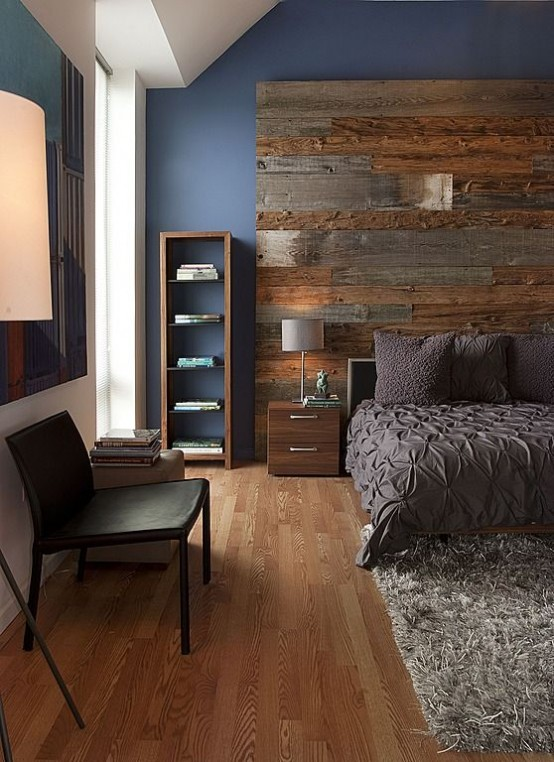 an accent weathered and aged wood wall makes a contemproary bedroom more rustic and adds coziness