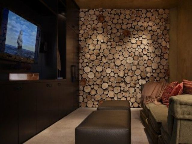 a wood slice accent wall makes the living room rustic and cozy and hides a non working fireplace at the same time
