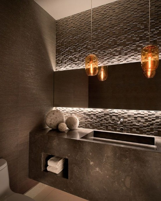 a geometric 3D concrete wall and a concrete floating sink add an edge to the bathroom