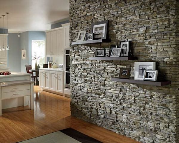 a textural stone accent wall adds interest and eye cathciness to the vintage inspired space in white and light blue