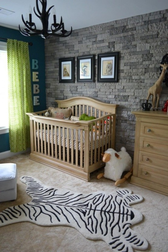 a faux stone wall adds a rustic feel to the nursery and is safe for kids and adults