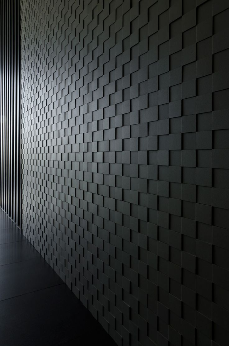 a 3D dark panel is a great option to cover your walls and make them catchy, bold and very modern