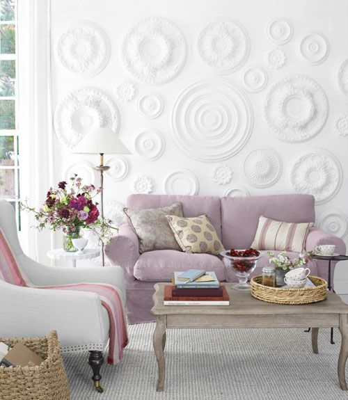 a fantastic white 3D wall done with eceiling medallions attached to it and painted adds refined chic