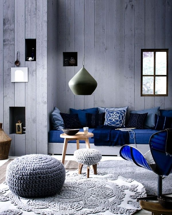 a whitewashed wooden wall makes the living room relaxed and adds somewhat a shabby feel to it