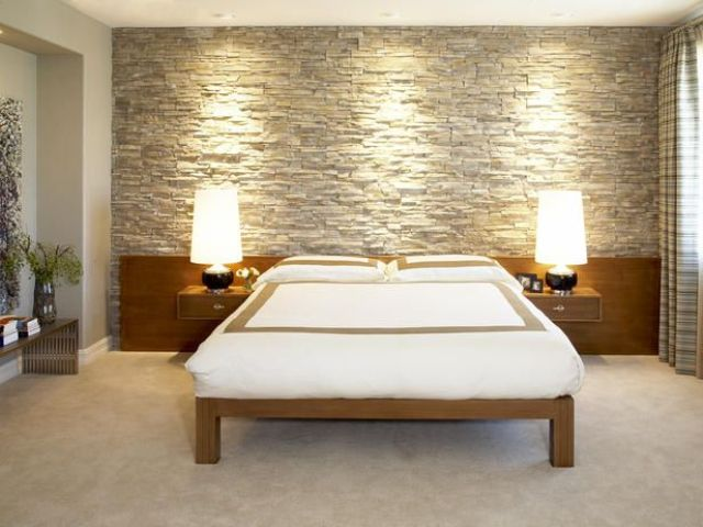 a faux stone statement wall is easier to install than a real one and will add a cozy rustic feel to the bedroom