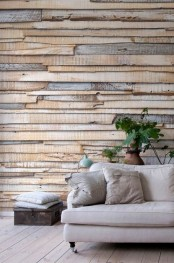a textured wooden plank accent wlal will instantly bring a cozy rustic feel to the space and make it more welcoming