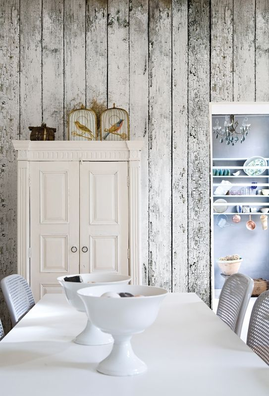 a shabby chic whitewashed wood plank wall makes the contemporary space more refined and gives it a character