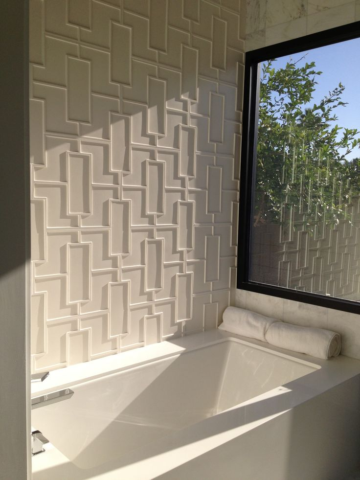 panels are a very popular idea to make a textural accent wall in any room and they can withstand moisture