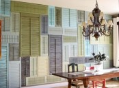 an accent wall all clad with colorful vintage shutters is a very bold and chic solution for the space