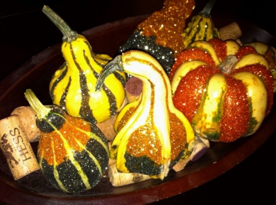 a bowl with faux pumpkins and wine corks is a simple and cool decoration for a coffee table