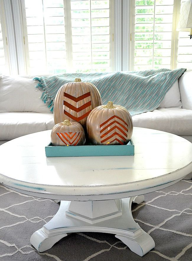 a turquoise tray with three white cutout chevron pumpkins is a simple and modern option for decor