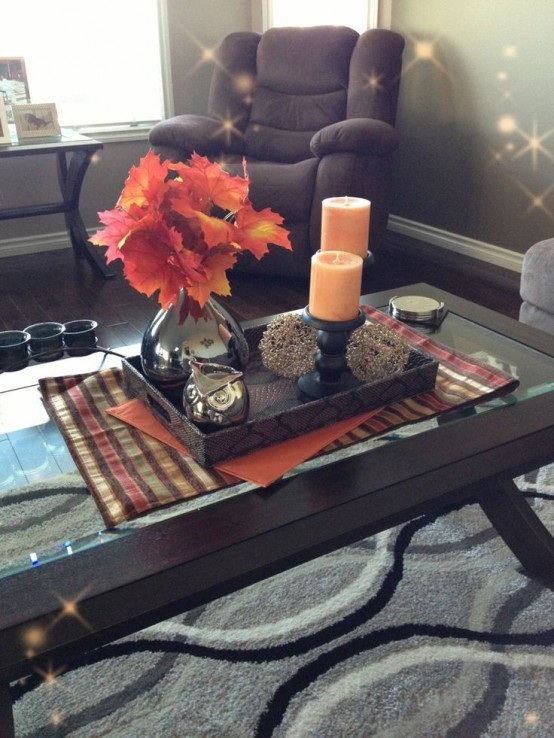 fall leaves, colored candles and an owl figurine are all you need for fall home decor
