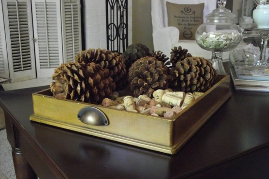 a tray with pinecones and wine corks is a simple rustic decoration for the fall or winter