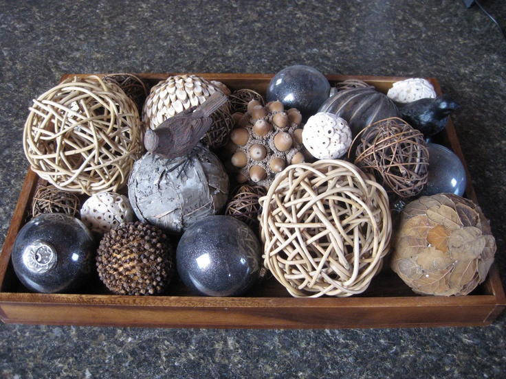 a tray with acorns, twine balls, sequin ornaments and navy glas sones for cozy fall home decor