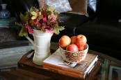 a bowl with apples and a jug with bright fall leaves will be a nice and natural fall coffee decoration