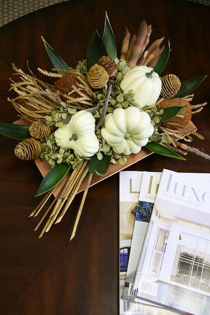 a fall arrangement of dried blooms, twigs, branches, leaves and white pumpkins is an easy option for the fall