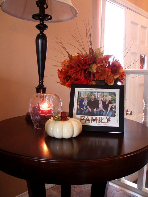 a white pumpkin and a bright fall floral arrangement with leaves for natural and cool fall decor