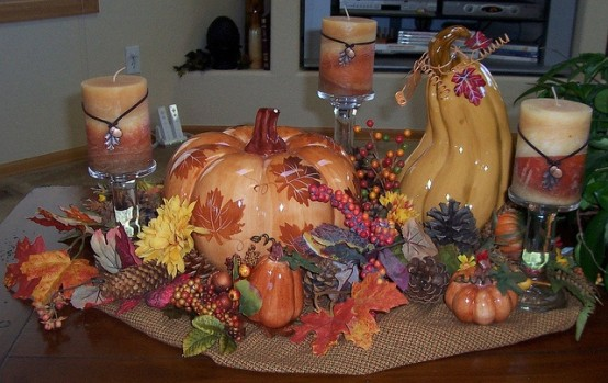 burlap, fake fall leaves, pumpkins,pinecones and berries plus fall-colored candles on each side