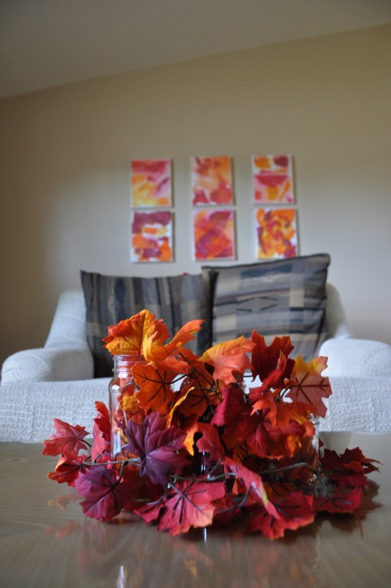 an arrangement of super bright faux fall leaves is all you need to bright a strong fall feel to the space