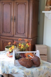 large faux acorns, pumpkins, bright fall florals in the pot are amazing and easy for fall decor