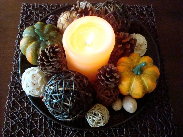 a bowl with pinecones, fresh and faux pumpkins, twine balls and candles for a centerpiece or for fall coffee table decor