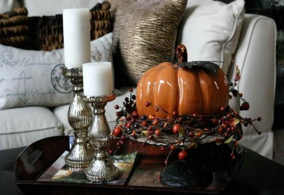 a tray with candles and a faux pumpkin with berries on a stand is a super cool idea for coffee table decor