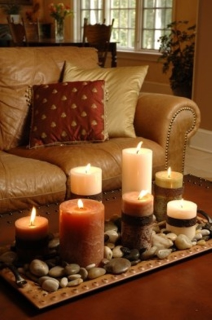 a tray with pebbles and colored candles will work not only for the fall but also for any other season