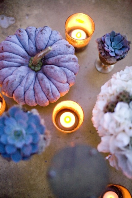 a purple pumpkin, purple succulents and candles in candleholders for chic and out of the box fall decor