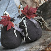 black fabric pumpkins with printed tops, striped ribbons and bold fall leaves look unusual and will fit Halloween, too