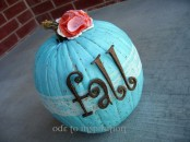 a blue pumpkin with a lace ribbon, quirky letters and bright fabric blooms on top is very fun and chic