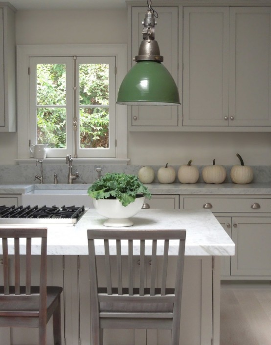 white pumpkins placed on your countertop will bring an elegant fall feel to your kitchen