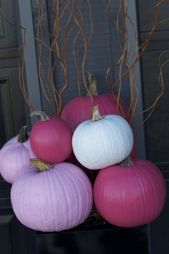 lavender, light pink, fuchsia and white pumpkins stacked will give an unusual bold touch to your space and a fall feel