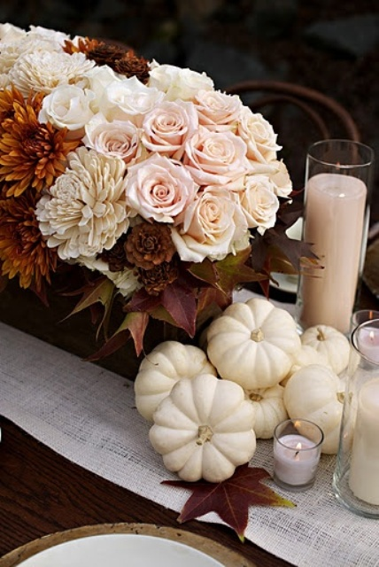 a rust, blush and white floral arrangement, white pumpkins and blush candles are fabulous and chic fall decorations