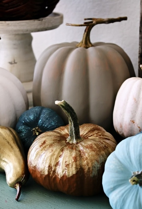 shiny gold, blue and blush pumpkins and gourds look cool and modern, they don't hint on anything rustic
