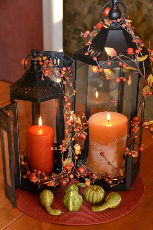 You can connect several lanterns in one centerpiece with several twigs with berries.