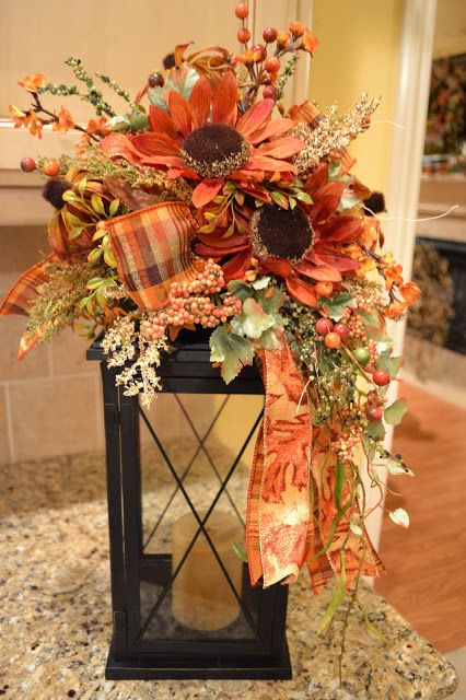 A large enough lantern could become a great stand for a fall blooms bouquet.