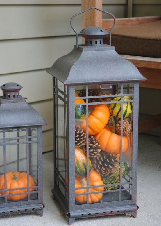 Mixing small gourds, pumpkins and pinecones is a simple way to stuff your lanterns.