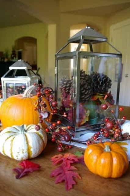 If their size allows, stuff you lanterns with pinecones. They would become great additions to any arrangements.