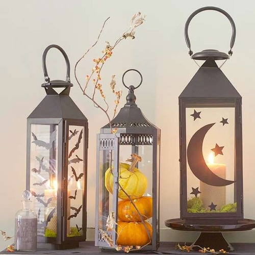 Cut a bunch of silhouettes and glue them to lanterns to make a great piece of decor for Halloween.