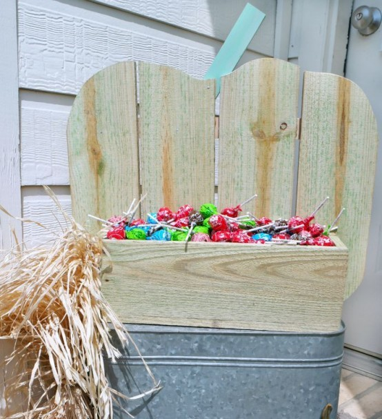 a neutral pumpkin-shaped stand with candies is a gorgeous solution for indoors and outdoors