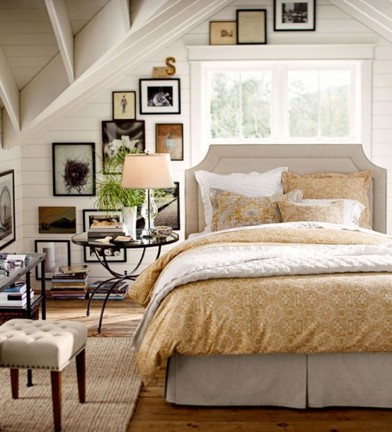 a farmhouse bedroom in white and neutrals, with a gallery wall and refined furniture