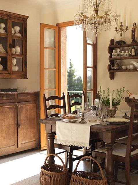 a cozy farmhouse dining nook with a wooden dining set, baskets and shelf with pottery