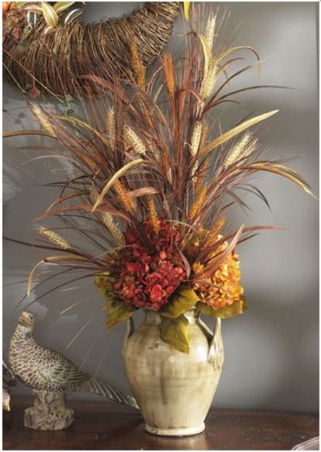 a neutral vase with dried grasses and bright faux blooms is a stylish fall centerpiece or decoration