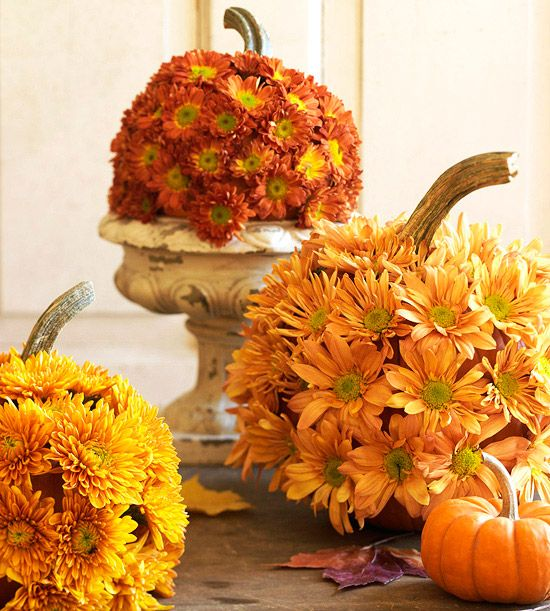 fall pumpkins covered with bright faux blooms are stylish fall decor and can be used both indoors and outdoors
