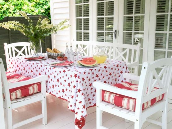 Festive Deck With Red And White Textiles