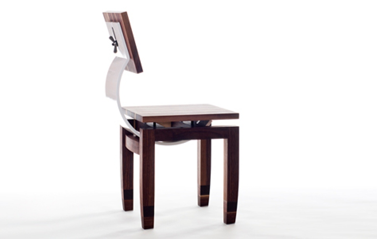 Flexible And Functional Chair With A Regulated Back