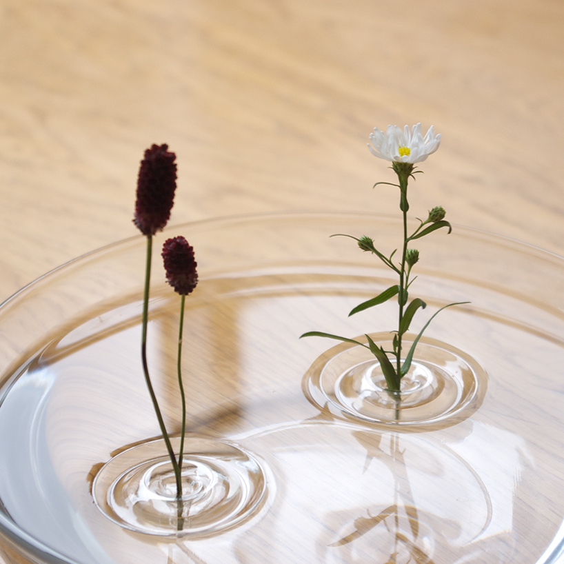Advertisement for Floating flowers in water